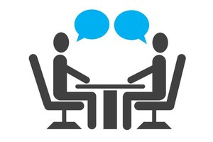 Drawing of two people talking across a table from each other.
