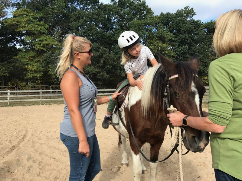 A special needs student finds freedom riding a horse.