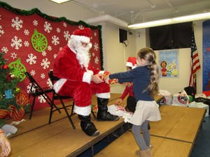little girl receiving a gift from Santa