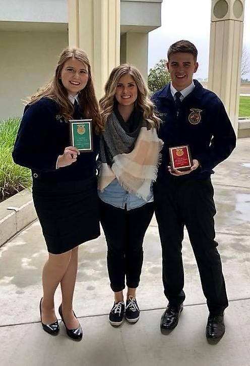 FFA State Speaking Finalists Kylie Farmer and Zach Santos with Coach Kassie Dewey