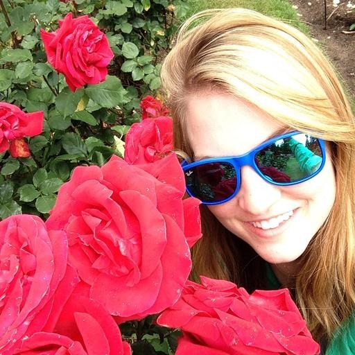 Maddie Barker smiling with roses
