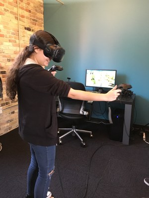 A TKHS computer science student tests the virtual reality program at Carnevale.