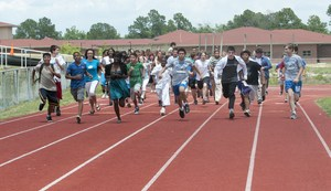 Group of students running on a track