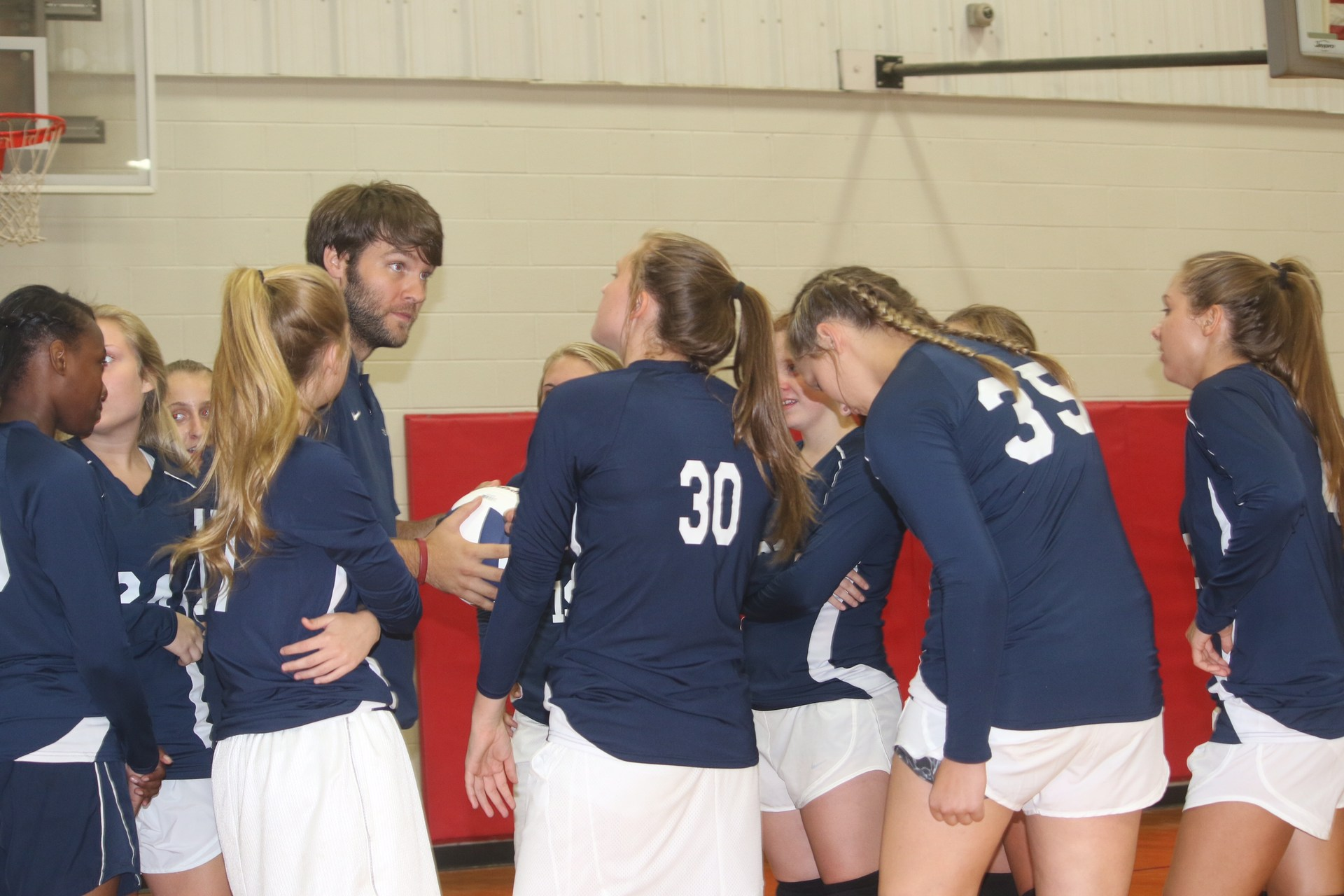 coach talking to team