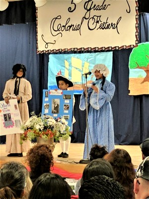 Tracy Elementary School fifth-graders give a presentation for an audience that included 200 parents and district leaders on March 30 during the school's fifth annual Colonial Festival. Student also sang and danced while guests were served tea and cookies.