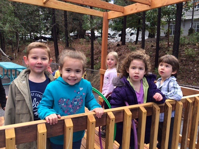Transitional Kindergarten students on play structure.