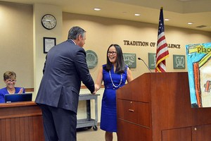Placentia Library Director Jeanette Contreras is surprised by PYLUSD Superintendent Dr. Greg Plutko with a