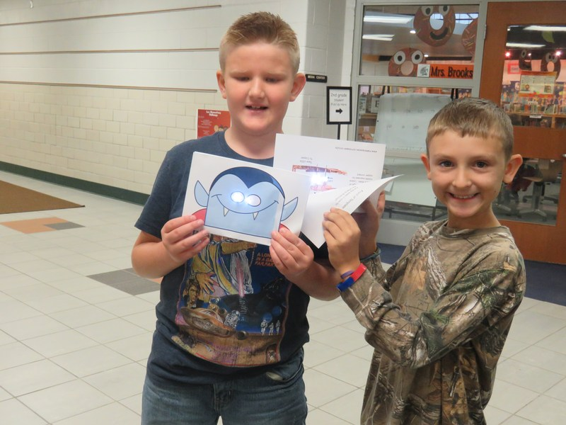 Lee students complete a close circuit project to make glowing Halloween projects.