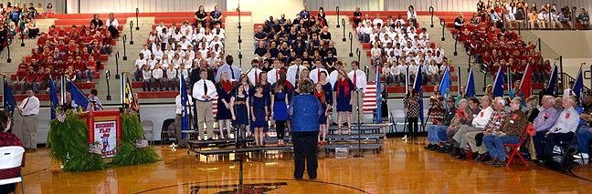 gym with choir singing