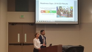 Mr. Cruz and the Director of Early Learning Presenting during a Board Meeting