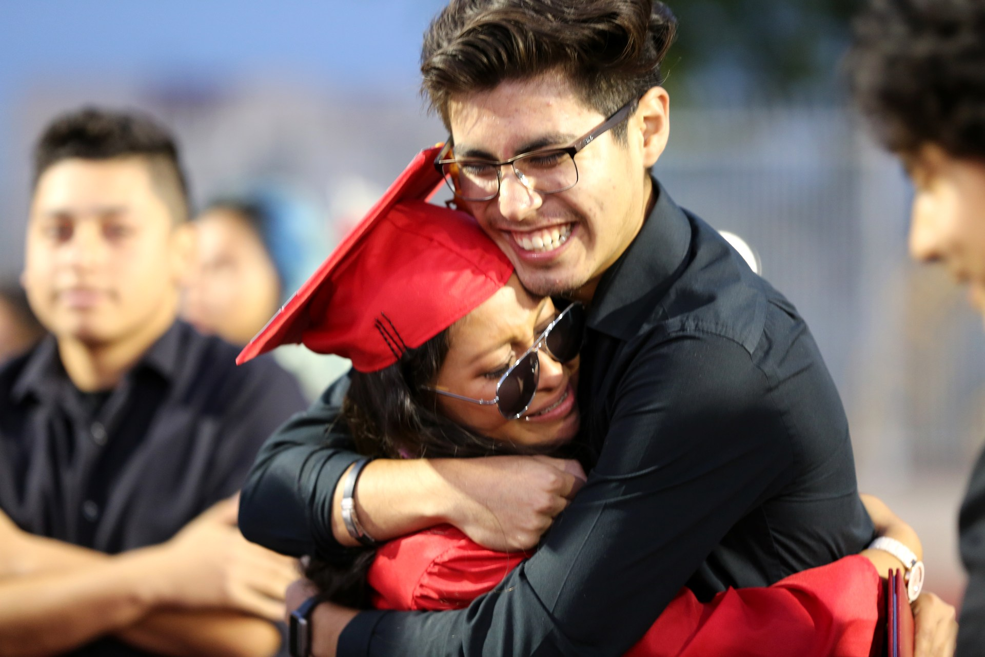 Graduates Hugging Photo