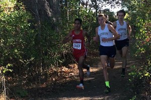 Shuaib Aljabaly and Alex Comerford are neck and neck during Saturday's race with Will Finch close behind.