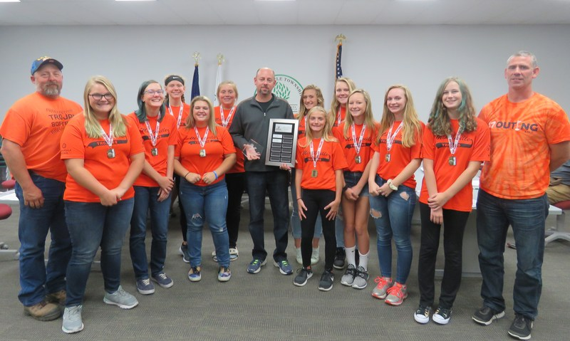 Pete Bailey is surrounded by his softball team while receiving the Andy Saldivar Coach of the Y ear Award from the TAPRC.