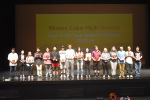Students who received an award lined up onstage