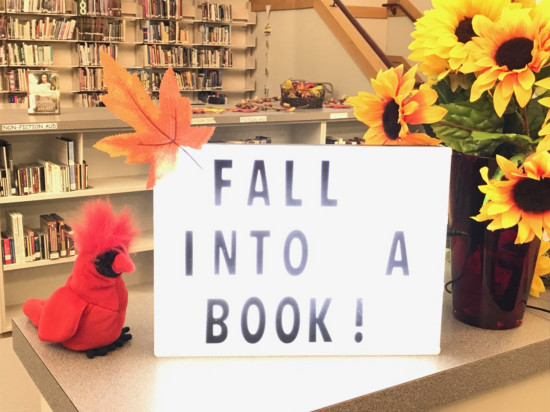 fall into a book sign