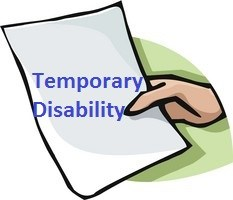 Hand with paper with Temporary Disability typed on it