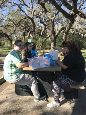 students participate in an educational activity while on their field trip to the Aransas National Wildlife Refuge