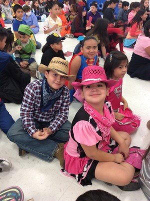 Students dressed as cowboy and cowgirl.
