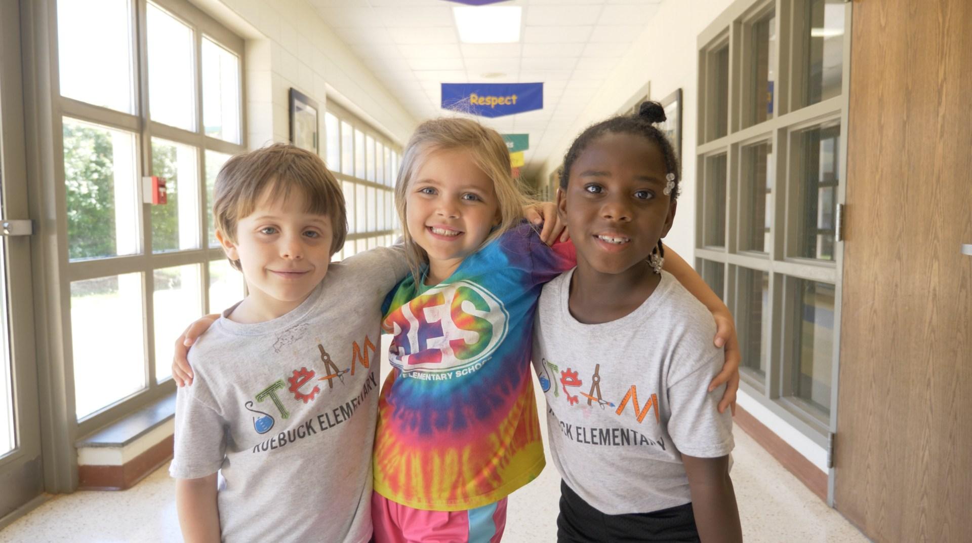 Kids smiling in hallway