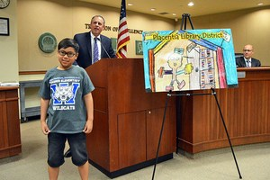 PYLUSD Superintendent Dr. Greg Plutko recognizes Wagner Elementary School fifth grader Jacob Adarlo's winning Placentia Library card design
