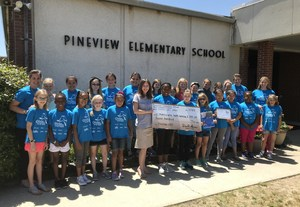 Pineview's Girls on the Run team members present the check to Make a Wish Foundation at the school.