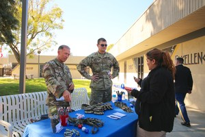 Student speaking with representatives from the army.
