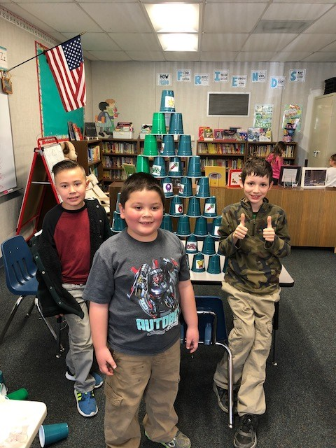 Students building cup tree