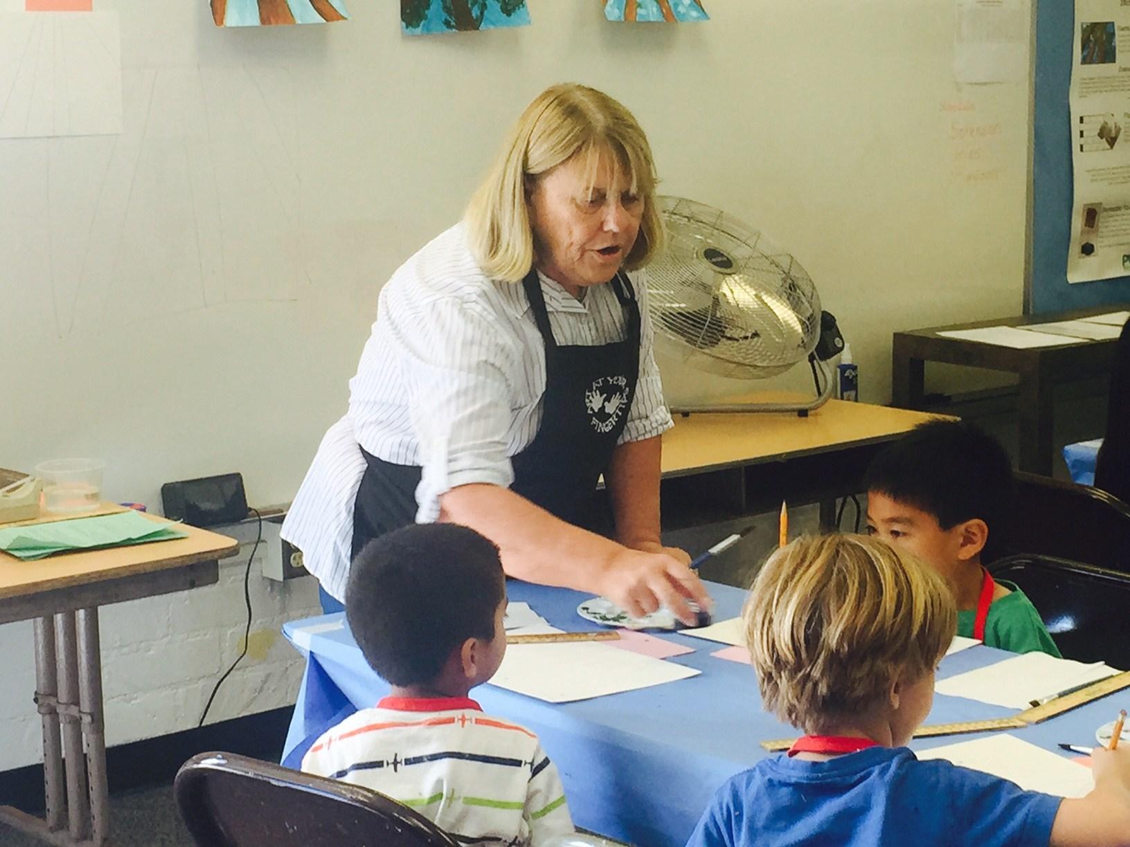 Mrs. Murin leads an art class