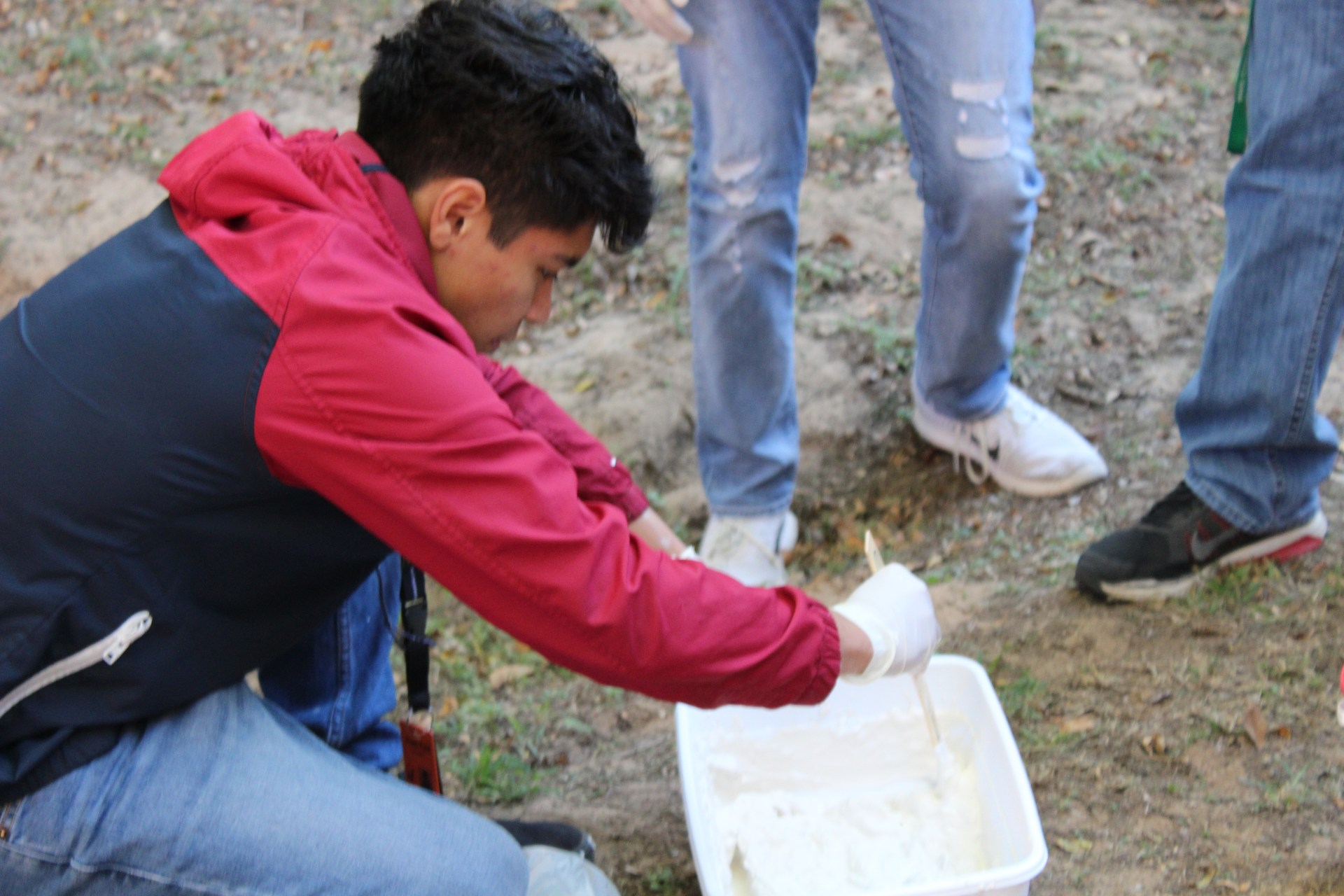 Forensic science students pour foot prints