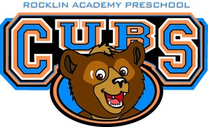 Cub with school logo behind jpeg.jpg