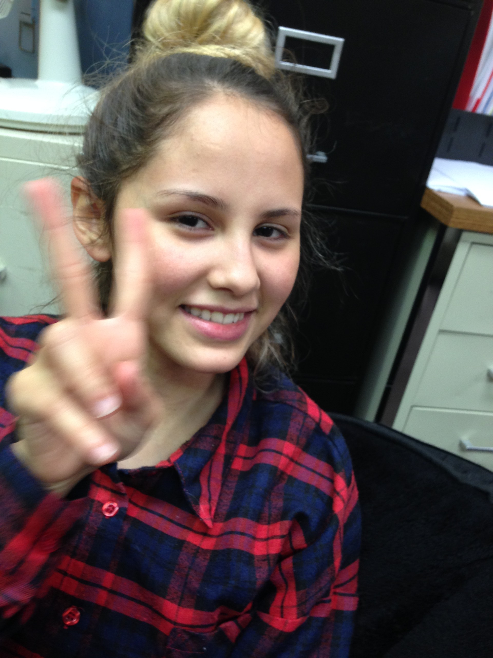 Bianca making a peace sign.