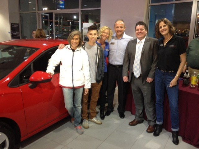 (L to R) Car winner Amy Juico, Christian Juico, Amy Daniels, WiSH Executive Director, Richard Cohn, WiSH Chairman, Mark LeCompte, AutoNation Chevrolet Valencia GM, Lynne Secrest, WiSH Vice Chair