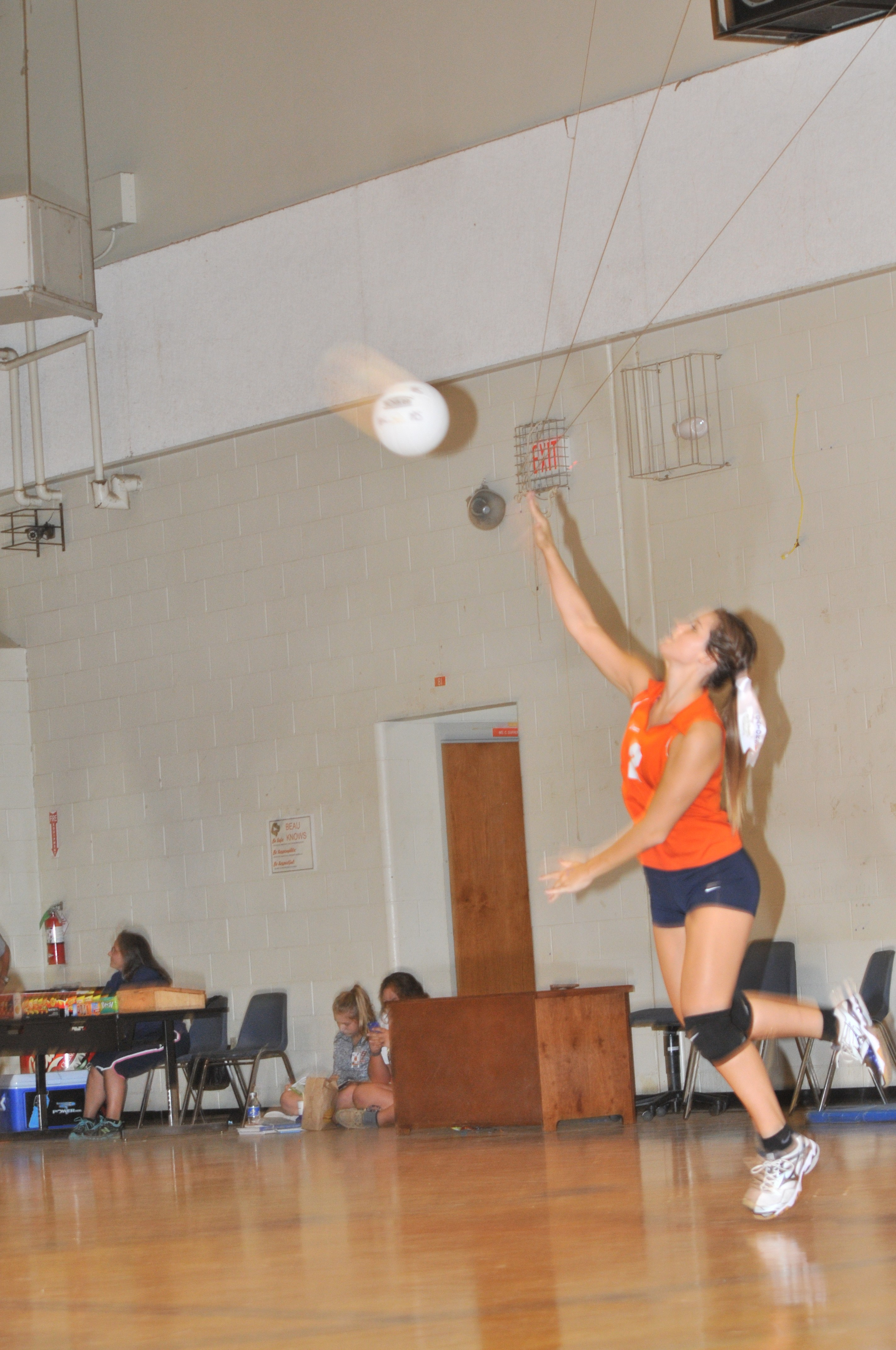 BCHS Volleyball member practicing drill.