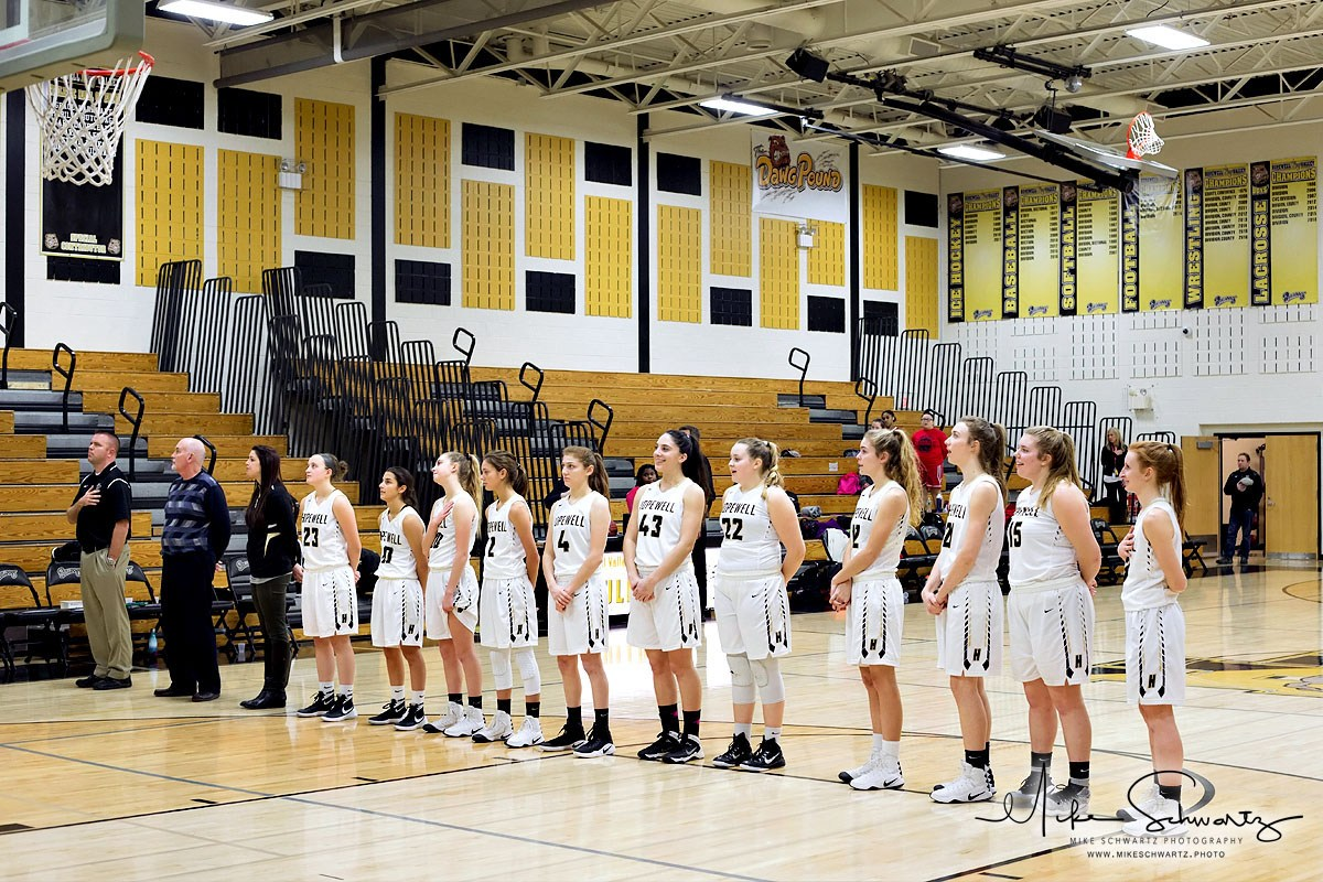 CHS girls basketball team lines up for the National Anthem