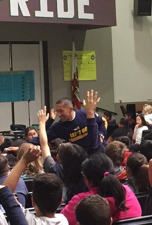 North Mountain Middle School Principal Gil Rodriguez has 7th grade students answer questions about attending college