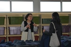 Parent volunteer at used uniform sale.JPG