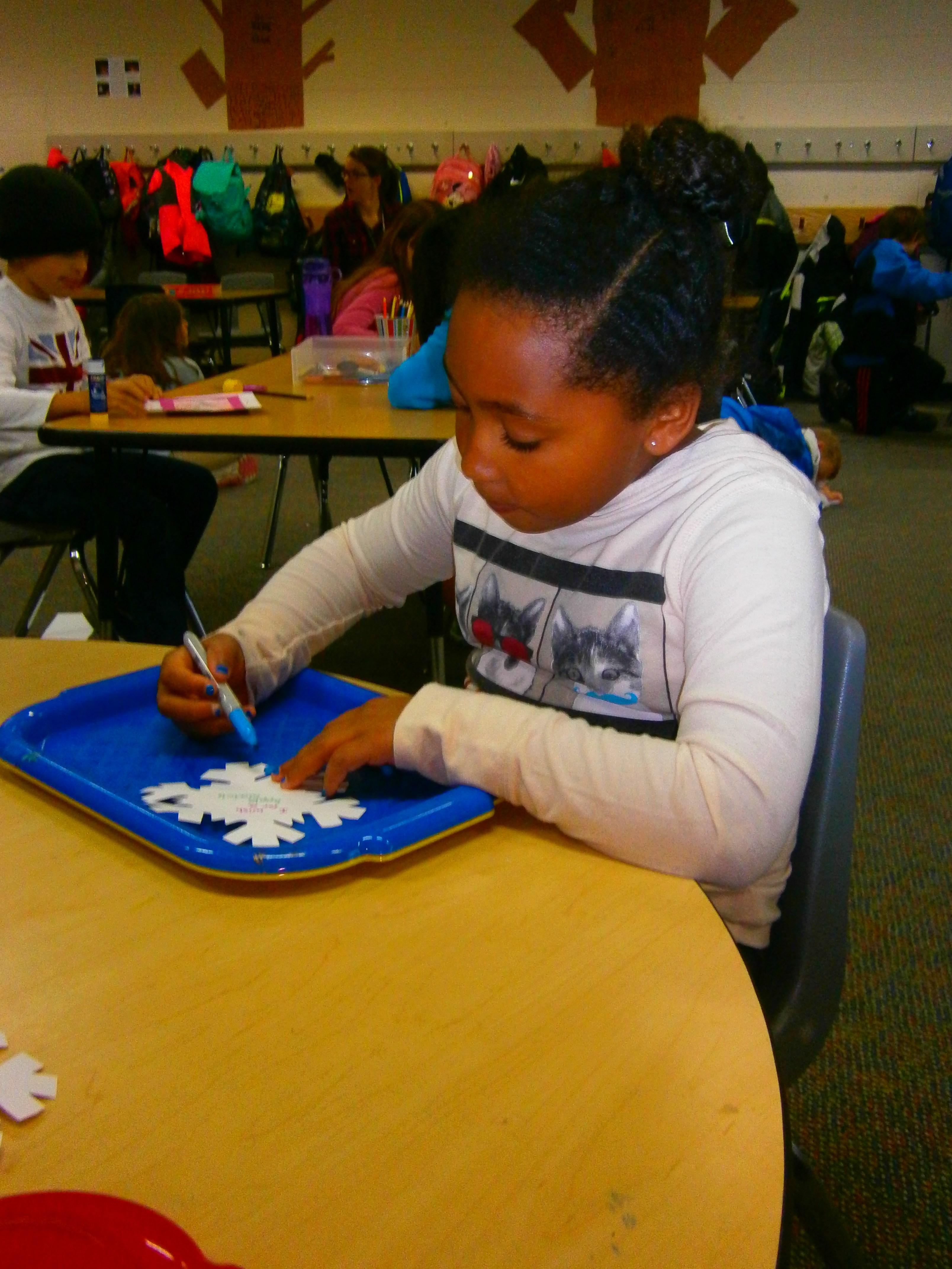 Decorating a snowflake.