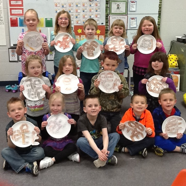 Students holding paper plates.