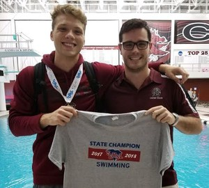 Brookland-Cayce swimmer Nathan Walton, left, and assistant coach Christian Mowles