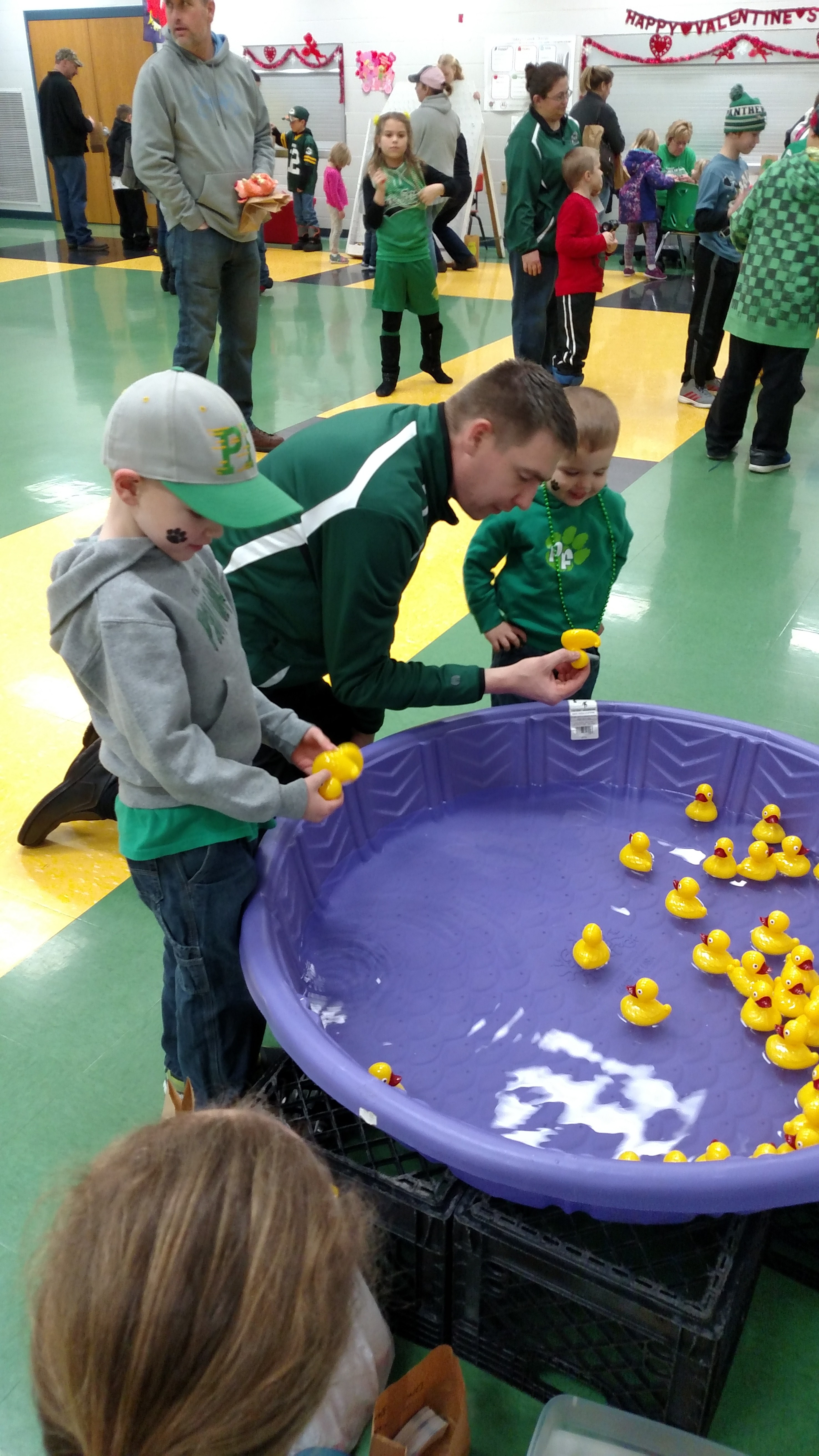 Students with rubber duckies in pool.