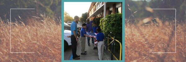 Students help put up the American flag.