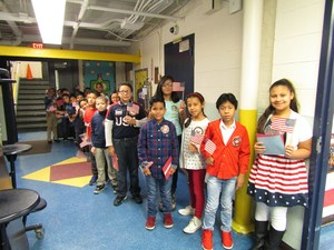 Mrs. L's 4th grade students ready for assembly