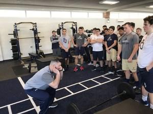 Joe Lopez teaches football players workout