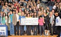FHS students holding check from Brookshires