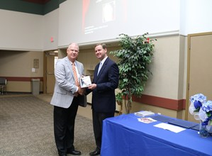 Mr. Evans receiving award from Trent Ashby.jpg