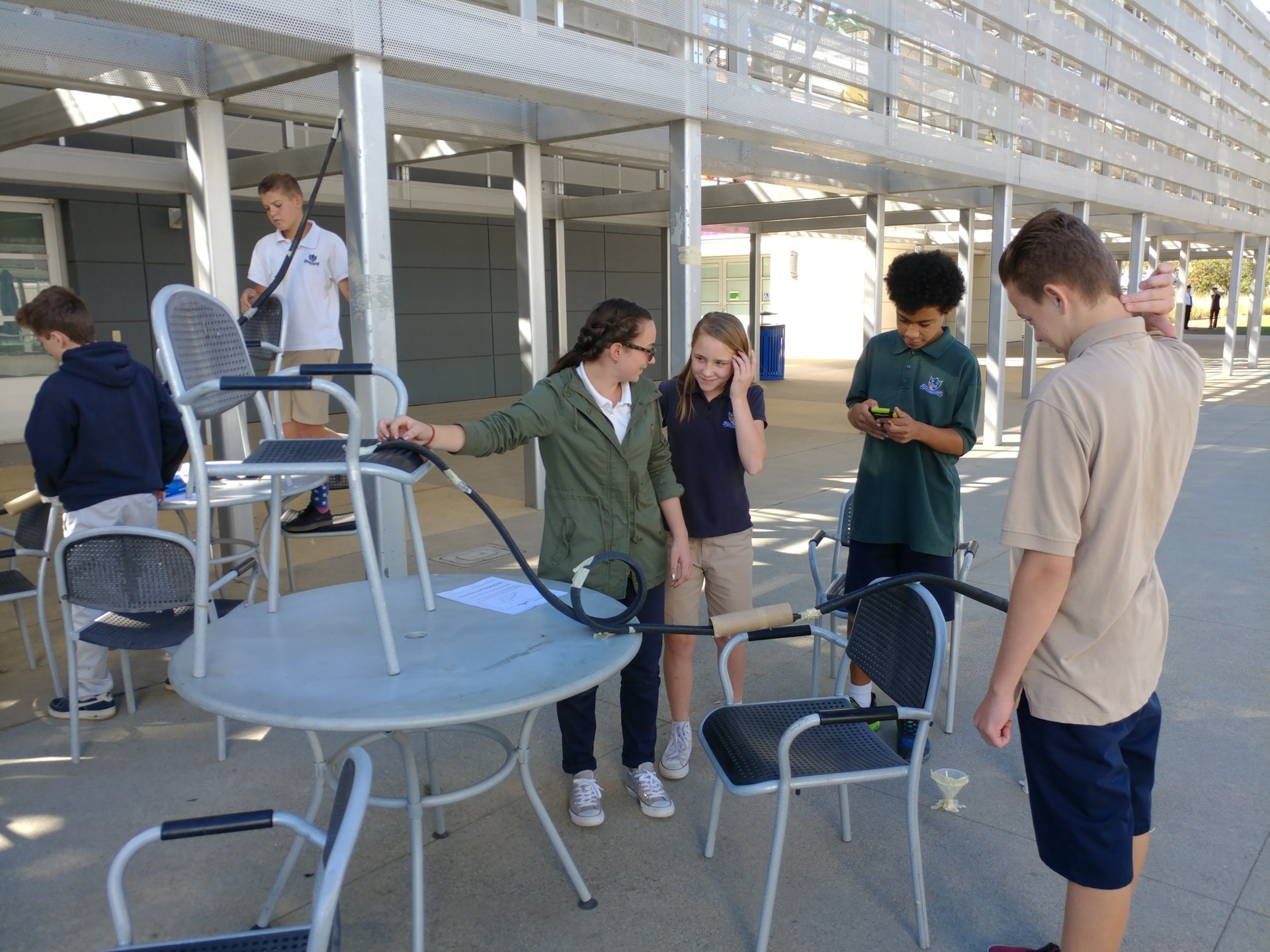 Students making marble roller coasters.