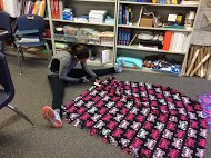 Photo of student cutting a no-sew blanket