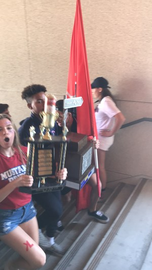 Rolling rally participants carrying the battle of the blvd trophy