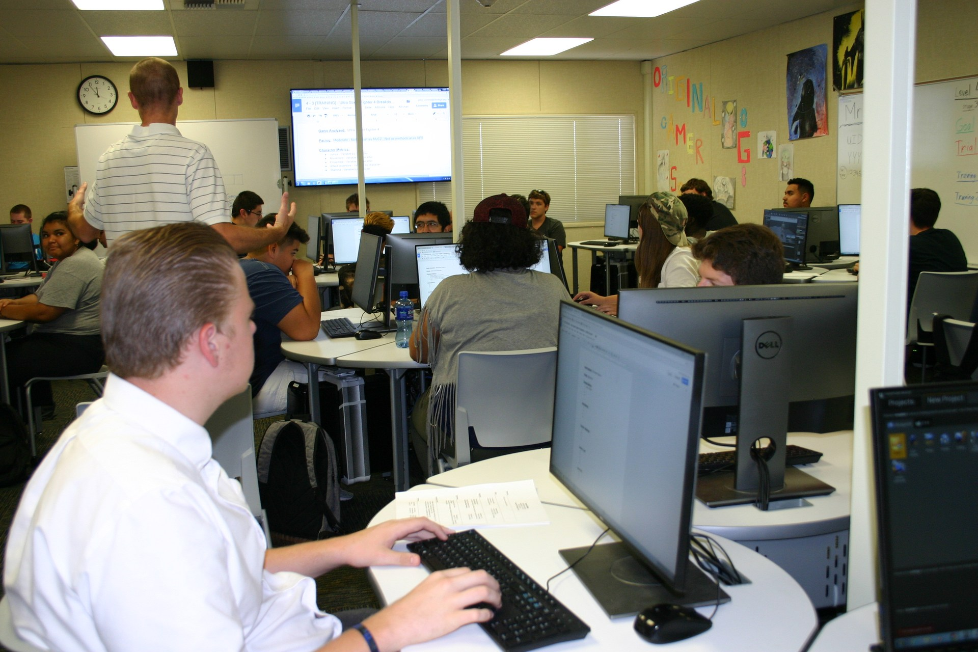 students at computer in video game design course