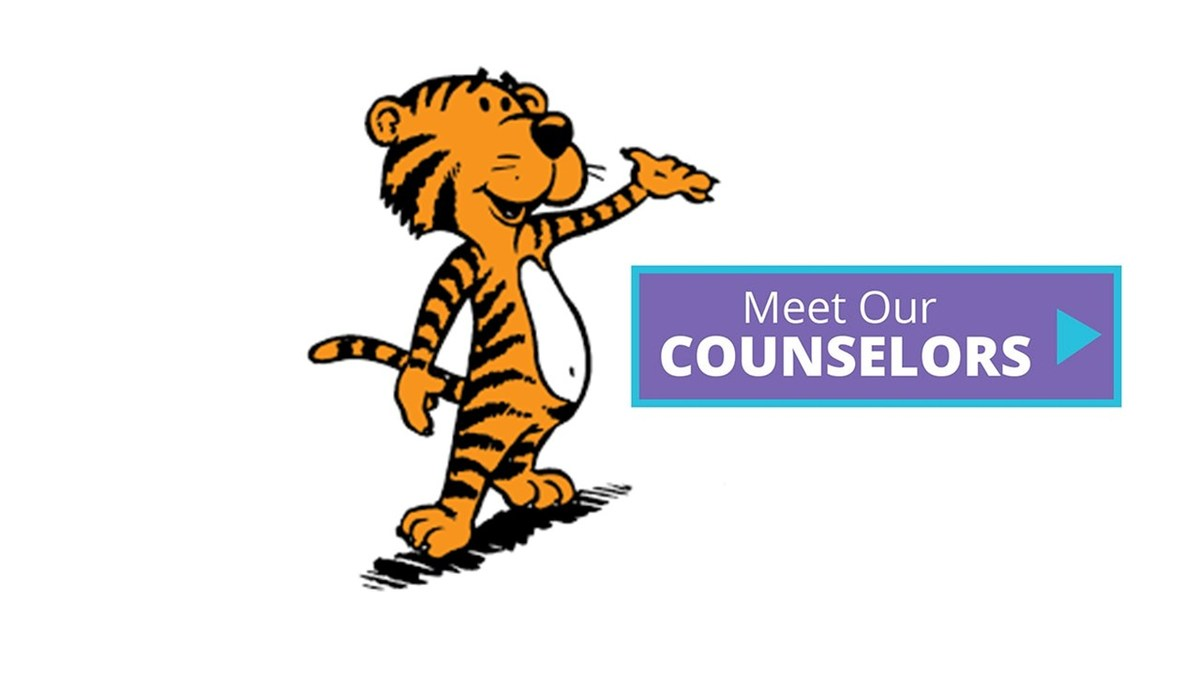 Tiger with counselor sign